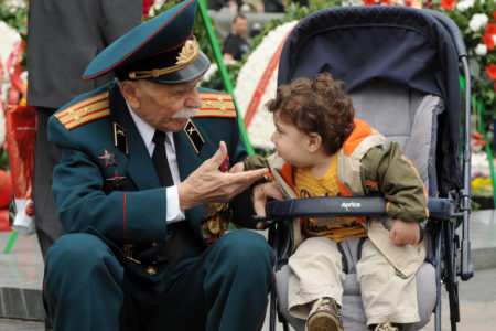 A World War II veteran speaks with a little child during Victory Day celebration in the Armenian capital Yerevan. Armenia as well as the other former Soviet republics celebrates the 1945 victory over Nazi Germany, the date of the Nazis' capitulation to the Soviet Union, which took place in the evening on May 8, 1945 (May 9 by Moscow Time), following the original capitulation Germany agreed earlier to the joint Allied forces on the Western Front.  (Karen Minasyan/Getty Images)
